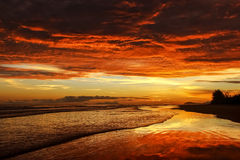Awesome bright colorful sunrise over the sea. Borneo, Kalimantan Royalty Free Stock Photo
