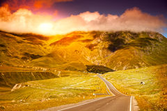 Awesome bright sunset in the mountains Stock Photos