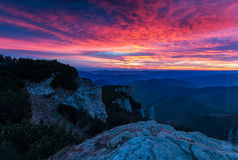 Awesome colorful sunset over the mountain hills Stock Photography