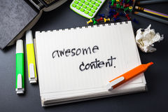 Awesome content. Handwriting of Awesome Content word in notebook for website content concept Stock Photo