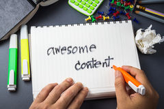 Awesome content. Handwriting of Awesome Content word in notebook for website content concept Royalty Free Stock Photos