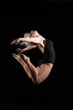 Awesome dance move by young woman in full flight Royalty Free Stock Images