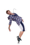 Awesome dancer standing on his tip toes. Picture of an awesome dancer standing on his tip toes making a cool dance pose royalty free stock photography