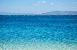Awesome deep blue sea water shining in the sun Stock Photo