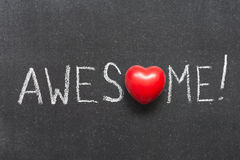 Awesome. Exclamation handwritten on chalkboard with heart symbol instead of O royalty free stock images