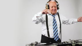 Awesome grandpa DJ. A very funky elderly grandpa dj mixing records