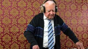 Awesome grandpa DJ stock video footage