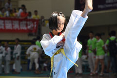 An awesome kick by a little girl--The seventh GoldenTeam Cup Taekwondo friendly competition Royalty Free Stock Image