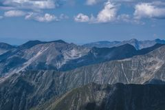 Rays of light on mountain ridges seen from Moldoveanu peak on a lovely summer day royalty free stock photo