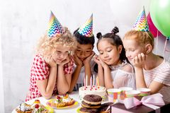 Awesome little girls and boy want to taste cake. And start the celebration . close up photo stock photos