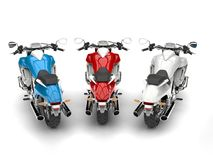 Awesome modern chopper bikes - red, white and blue - top down back view. 3D Illustration Stock Images