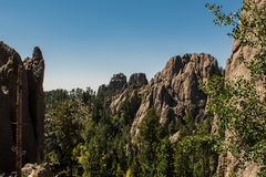 Awesome mountain landscape at Blackhills National Forest , South Dakota , USA. Awesome mountain landscape with sharp rocks and green trees at Blackhills National stock photo