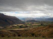 Awesome mountain valley view across the southern alps, New Zealand South Island. Crown Range Road scenic lookout in autumn, on the mountain road from Wanaka to stock photos