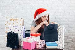 Awesome nice girl unpacking her present stock photos