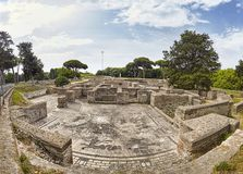 Awesome panoramic view in the Roman empire excavation ruins at Ostia Antica with the beautiful mosaic of Cisiarii thermal spa and. Awesome panoramic view in the stock photo