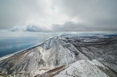 Awesome  peaks on Sakhalin island. Awesome peaks and endless valley on the Sakhalin island. March Royalty Free Stock Photography