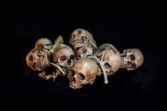 Awesome, pile of skull and bone, on black background, Stock Photo