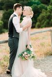 Awesome portrait of bride and groom hug each other tender royalty free stock photography