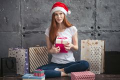 Awesome positive girl is thinking about New year royalty free stock image