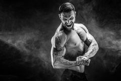 Handsome power athletic man bodybuilder. Fitness muscular body o. Awesome power athletic man bodybuilder screaming while flexing his muscles. Fitness muscular Royalty Free Stock Photo