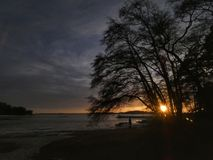 Awesome sunset ashore. Sunsets, sunsetpictures, photography, beautiful, outstanding, beautifulevening, finland, landscape, landscapes, finnishlandscape, trees royalty free stock photo