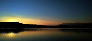 Awesome sunset on a lake. Another great susnet on the lake of viverone, in italy royalty free stock images