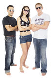 Awesome threesome 3. Standing full length with arms crossed and sunglasses Royalty Free Stock Image
