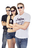 Awesome threesome 4. Standing with arms crossed and sunglasses Royalty Free Stock Image