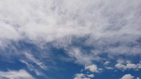 Awesome time lapse of white fluffy clouds formations in a summer beautiful blue sky with light effects and evanescent movements.  stock video