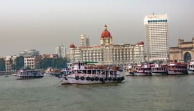 Awesome view of Hotel Taj & Gate way of India with boats on sea looking beautiful. This snap has taken from mumbai at the time of mumbai tour. this is a Royalty Free Stock Image