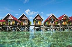 Awesome view of mabul island budget lodge. Blue sky and green sea view from mabul island lodge Stock Photos