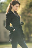 Awesome vintage woman looking away in trench coat at fall time Royalty Free Stock Photography