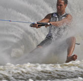 Awesome water ski action!. MCU World Champion Barefoot Water Skier, Andre de Villiers (RSA)  on one foot forwards in the slalom event Royalty Free Stock Photos