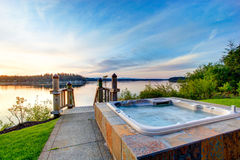 Awesome water view with hot tub at dusk in summer evening. Stock Photos