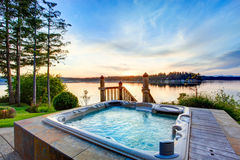 Awesome water view with hot tub in summer evening. Stock Photo