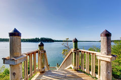 Awesome water view from the wooden staircase with railings. Royalty Free Stock Photography