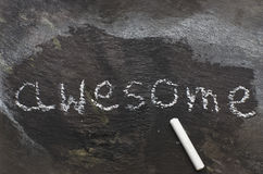 Awesome, written with white chalk on a blackboard Stock Images
