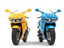 Awesome yellow and blue modern super sports bikes Stock Photos
