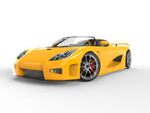 Awesome yellow sportscar - studio shot. Isolated on white background Royalty Free Stock Photography