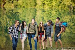 Awesome young smiling people are spending holidays on mountains royalty free stock photos