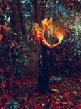 Awesome young witch conjures in the forest Royalty Free Stock Photo