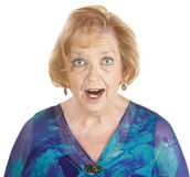 Awestruck Woman. Awestruck elderly woman in blue on isolated background Stock Photos