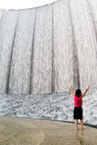 Awestruck woman at Fountain 2. Awestruck woman at fountain with arms upward Royalty Free Stock Photo