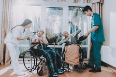 Awful.Current Affairs.Bad Service.Medical Workers. Awful. Current Affairs. Bad Service. Medical Workers. Argue with Elderly Couple. Nursing Home. Very Emotional stock image