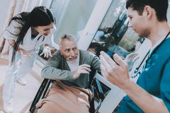 Awful Current Affairs in Hospital. Emotional Talk. Awful Current Affairs in Hospital. Very Emotional Talk. Elderly People Very Frightened. Medical Workers Argue stock photography