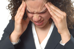 Awful migrain. Young businesswoman trying hard to get rid of a headache Stock Image