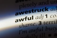 Awful. Word in a dictionary.  concept royalty free stock photos