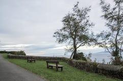 Ławka patrzeje nad Cantabrian morzem Fotografia Stock