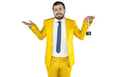 Awkward businessman holds euro symbol upside down Royalty Free Stock Photography