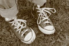 Awkward Feet. Converse Standing Awkward Royalty Free Stock Photo
